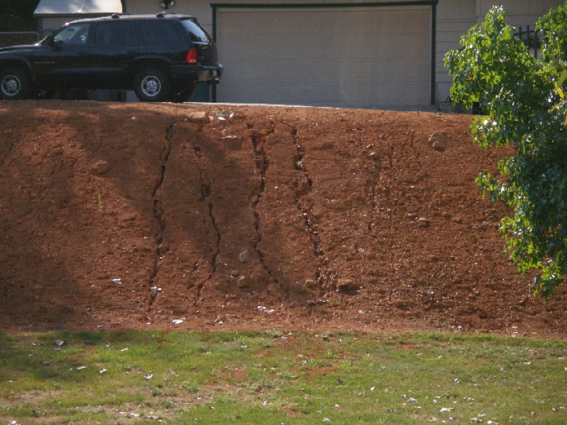 "Property owner has raked down to ""mineral soil"" for ""fire safety"" but now the erosion is undermining his own driveway."