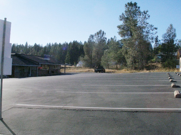 Photograph of vast asphalt parking lot.